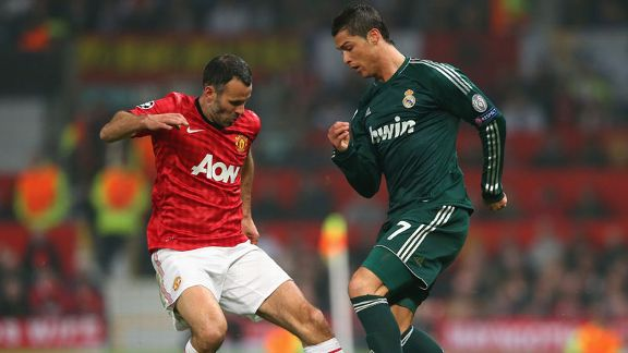 Ryan Giggs comes against his former Manchester United team-mate Cristiano Ronaldo
