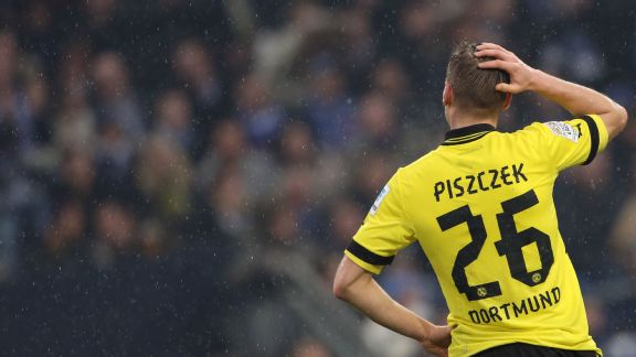 Dortmund's Lukasz Piszczek reacts to the 2-1 loss to Schalke