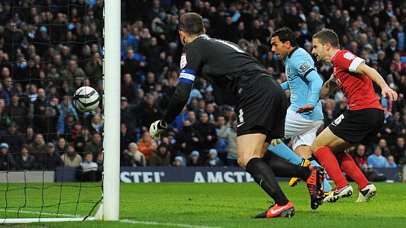 Carlos Tevez fires Man City into an early lead against Barnsley