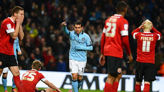 Carlos Tevez was the star of the show, notching a hat-trick as Man City thrashed Barnsley to reach the FA Cup quarter-finals