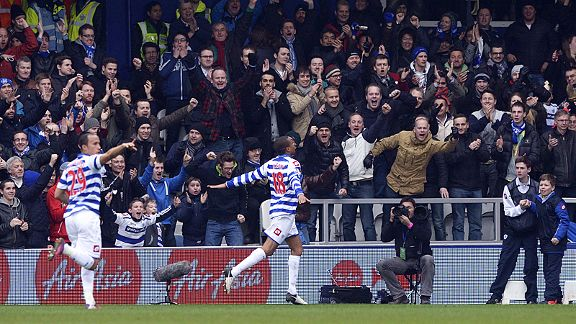 Loic Remy celebrates with the QPR fans after scoring their equaliser against Sunderland