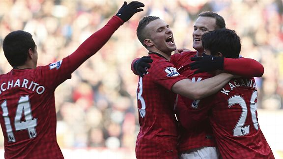 Man United celebrate Wayne Rooney goal against Chelsea as a floated free-kick bounced in