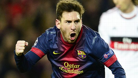 Lionel Messi celebrates after scoring his second goal against Milan