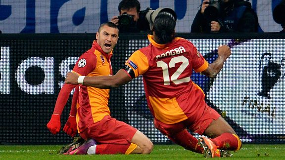 Burak Yilmaz celebrates his goal with Didier Drogba