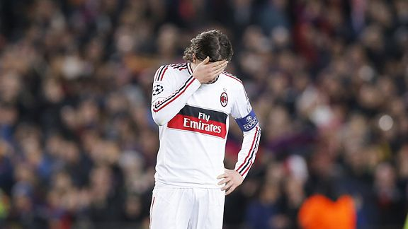 Riccardo Montolivio hides his face as Milan see their first-leg lead fade away