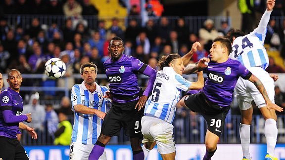 Roque Santa Cruz (24) heads Malaga into the quarter-finals at the expense of FC Porto