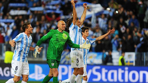 Malaga celebrate at full-time after ousting FC Porto 2-1 on aggregate