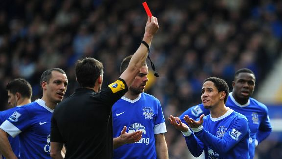 Lee Probert shows Everton midfielder Steven Pienaar a red card