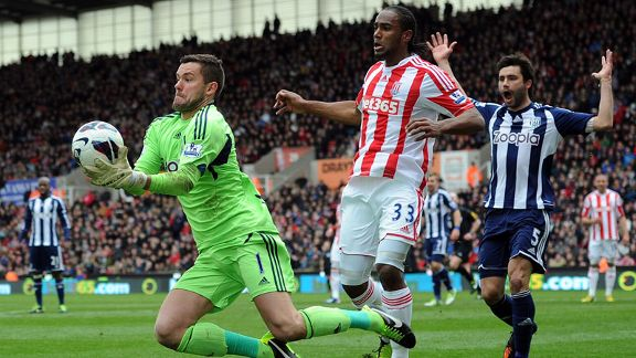 West Brom goalkeeper Ben Foster makes a save as Stoke striker Cameron Jerome closes in