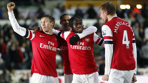 Gervinho celebrates with his team-mates after doubling Arsenal's lead