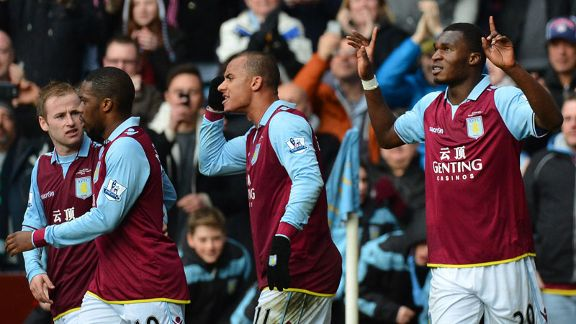 Christian Benteke celebrates after putting Villa into a 3-2 lead