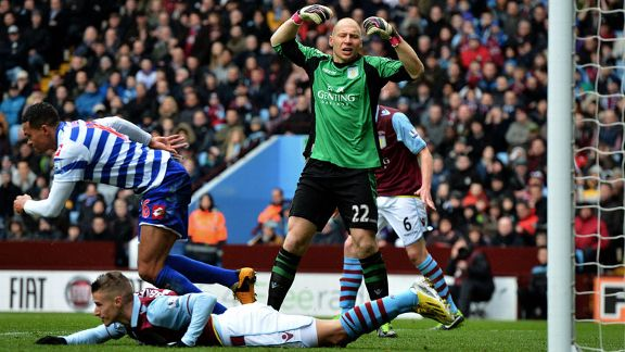 Aston Villa goalkeeper Brad Guzan shows his frustration after Jermaine Jenas gave QPR the lead
