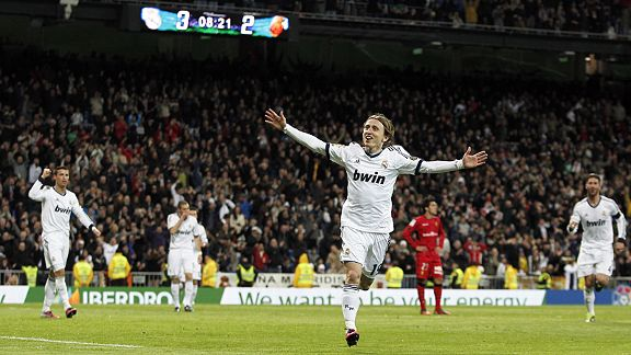 Luka Modric celebrates after his stunning strike put Real Madrid 3-2 up at home to Mallorca