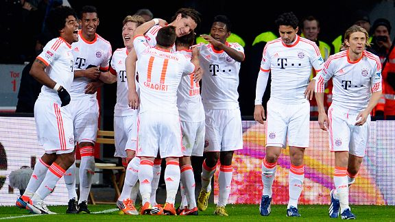 Bayern Munich celebrate after Philipp Wollscheid's own goal handed them victory