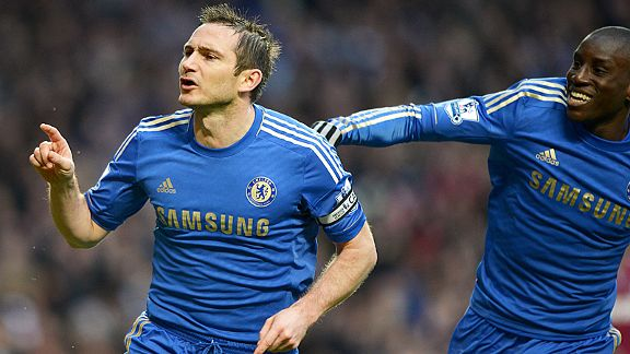 Demba Ba celebrates with Frank Lampard after the midfielder netted his 200th goal for Chelsea