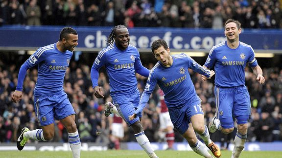 Eden Hazard celebrates with Chelsea team-mates after giving them a two-goal lead over West Ham