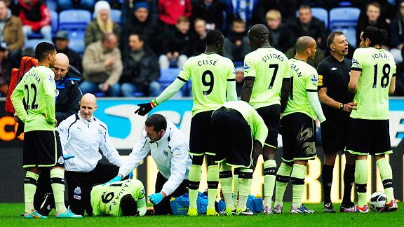 Massadio Haidara gets treatment as Newcastle's players protest to referee Mark Halsey