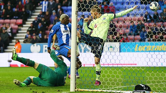 Arouna Kone forces home Wigan's late winner against Newcastle