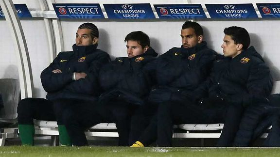 Lionel Messi takes his place on the bench for the second half after sustaining an injury