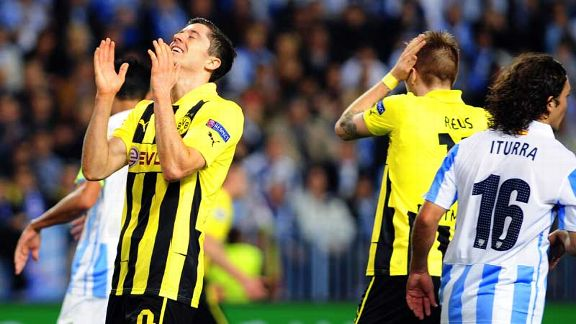 Robert Lewandowski shows his frustration after failing to score against Malaga