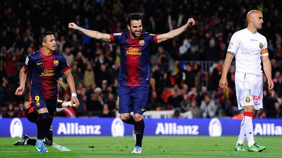 Cesc Fabregas celebrates after netting his third, and Barcelona's fifth, goal against Real Mallorca