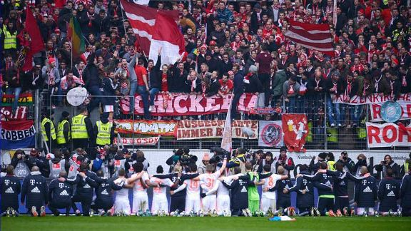 Bayern Munich celebrate in front of their supporters after winning the Bundesliga title