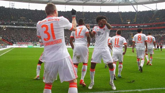 Bastian Schweinsteiger celebrates with Dante after breaking the deadlock