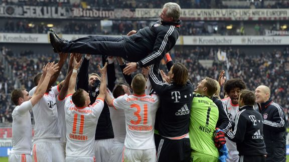 Bayern's players throw coach Jupp Heynckes in the air after securing the Bundesliga title