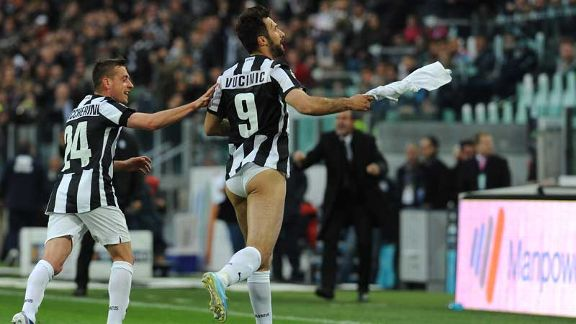 Mirko Vucinic celebrates scoring the opening goal by removing his shorts