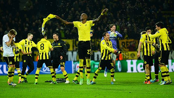 Dortmund players, led by Felipe Santana, celebrate their astonishing victory
