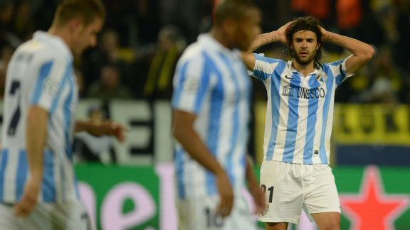 Malaga players react to losing 3-2 to Dortmund