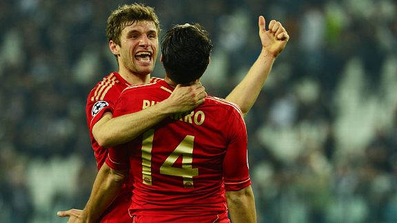 Thomas Muller celebrates with Claudio Pizarro after the Peruvian scored Bayern's second at Juve