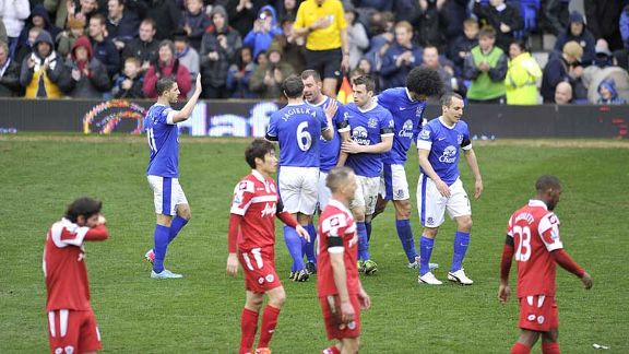 Everton celebrate after taking the lead through Darron Gibson