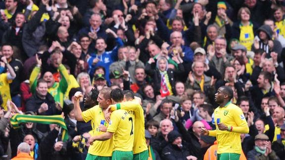 Michael Turner celebrates with his team-mates after heading Norwich into the lead
