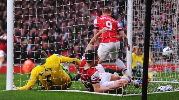 Olivier Giroud ends up in the back of the net after bundling the ball home to give Arsenal the lead