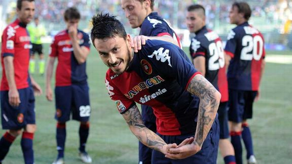 Mauricio Pinilla celebrates after netting his second goal against Inter