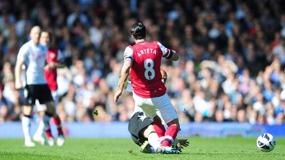 Steve Sidwell tackles Mikel Arteta, a challenge which earned him a red card