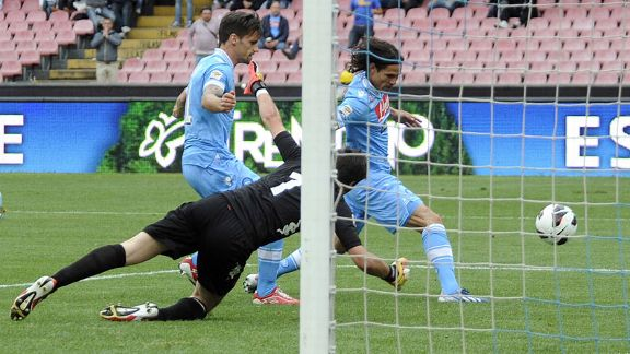 Edinson Cavani scores for Napoli in their Serie A game against Cagliari