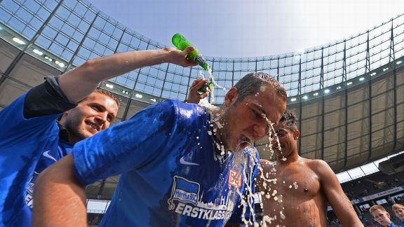 Hertha Berlin players celebrate their promotion to the Bundesliga