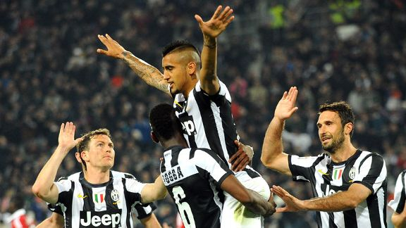 Arturo Vidal takes the plaudits of his Juventus team-mates after scoring against Milan