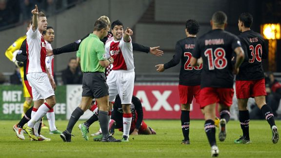 Luis Suarez later received a seven-match ban for biting PSV midfielder Otman Bakkal
