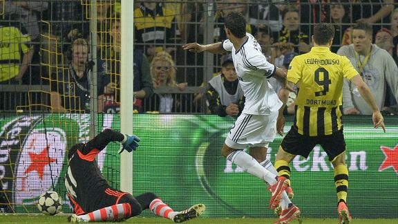 Robert Lewandowski scores his second of four against Real Madrid