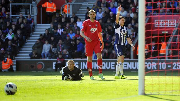 Shane Long celebrates after rounding off the scoring in West Brom's 3-0 win