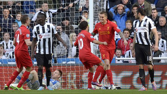 Daniel Agger celebrates after giving Liverpool the early lead