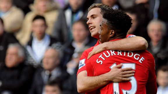 Jordan Henderson celebrates with Daniel Sturridge after doubling Liverpool's lead