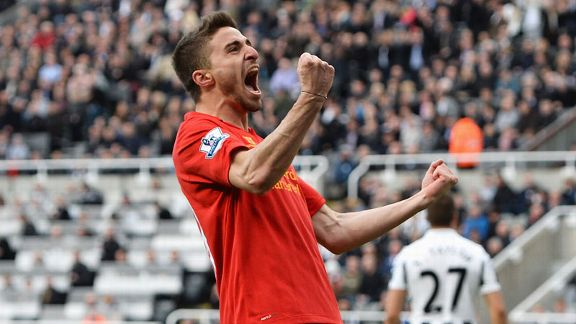 Fabio Borini celebrates after coming off the bench to make it 5-0 to Liverpool