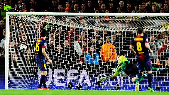 Victor Valdes dives in vain to try and stop Arjen Robben's shot from hitting the back of the net