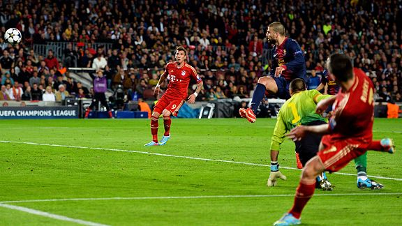 Gerard Pique slices Franck Ribery's cross into the back of his own net