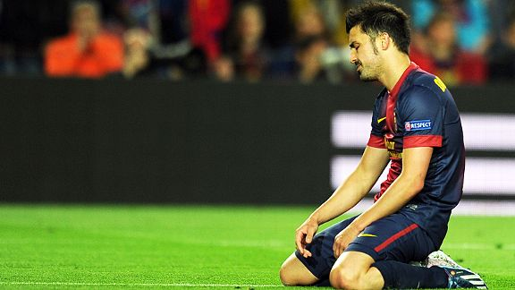 David Villa sinks to his knees as Barcelona head out of the Champions League with a whimper