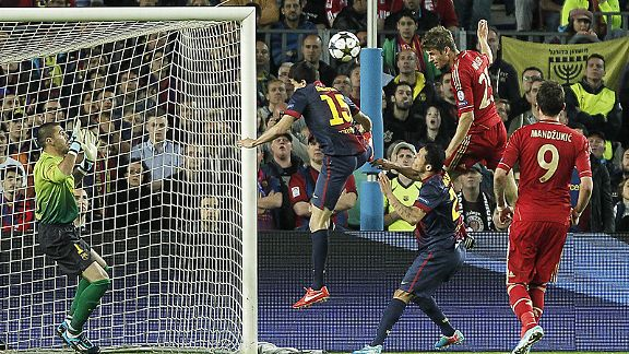 Thomas Muller heads home Bayern Munich's third goal at Barcelona